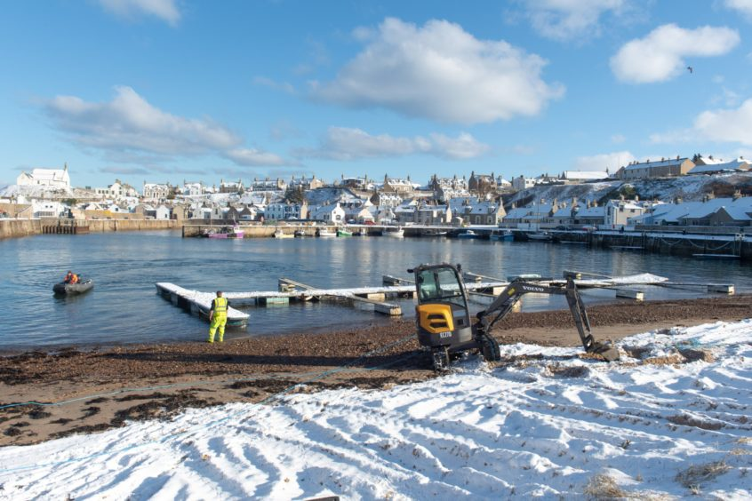 Contractors removing old pontoons at Findochty Harbour.