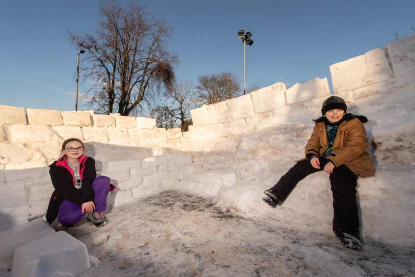 Louis Norgate and Charlie Smith, both 10, enjoy the snow.