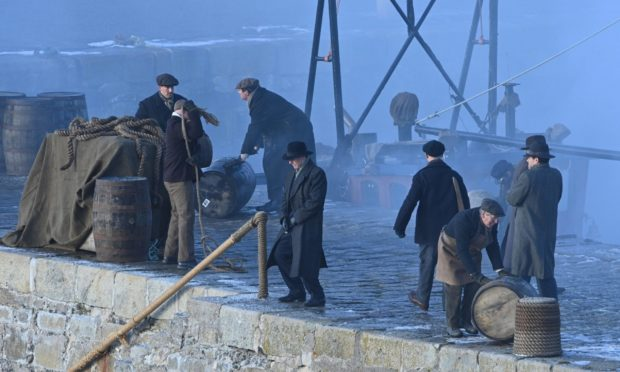 Scenes from Peaky blinders filmed at Portsoy harbour.