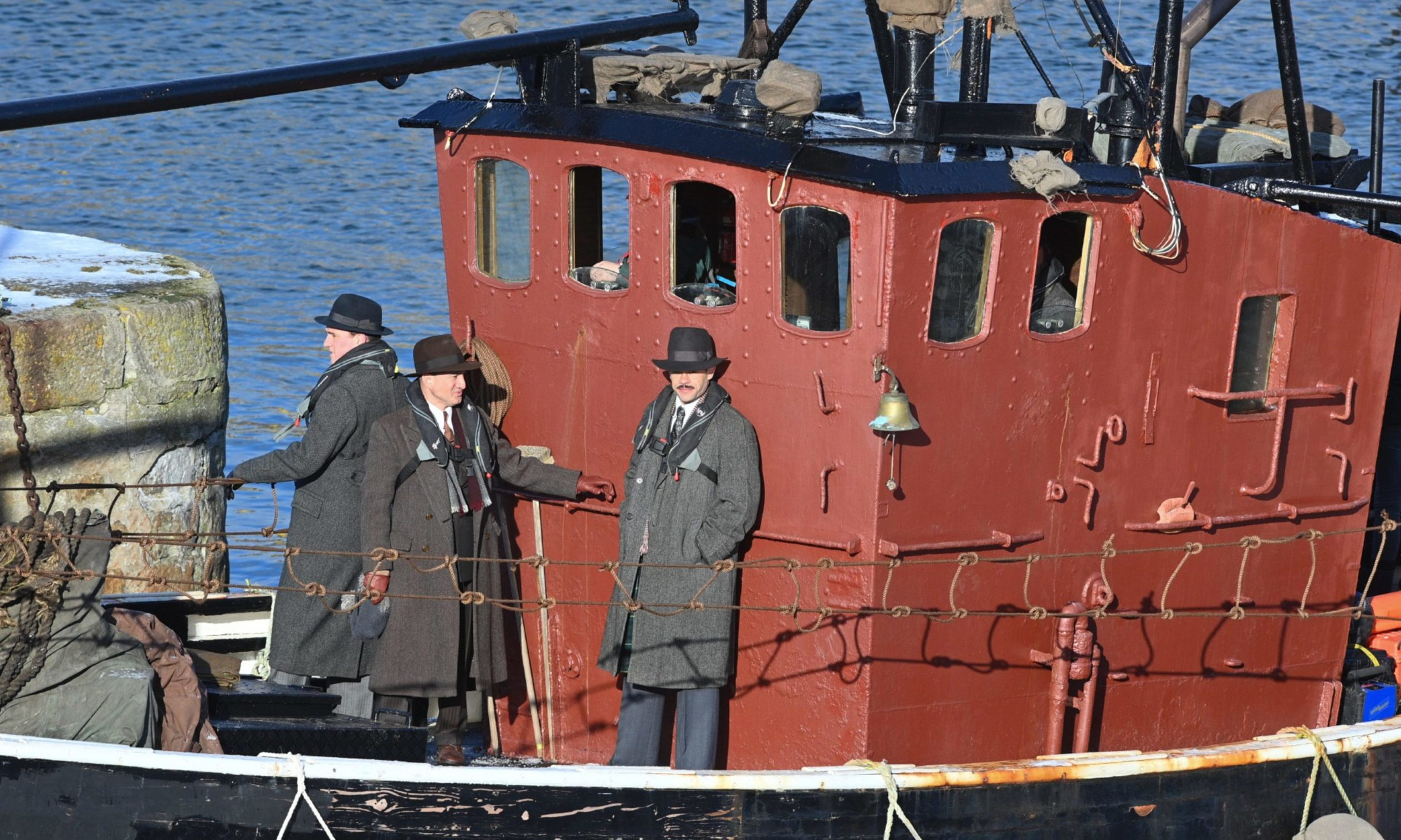 Some actors were seen on board a small red boat during Peaky Blinders filming.