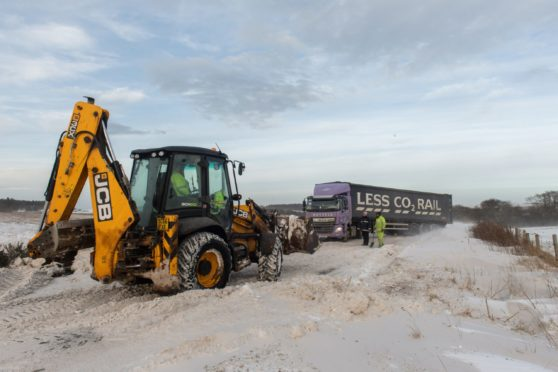Snow drifts and high winds caused chaos on the A98 Fochabers to Cullen section. Picture by Jason Hedges