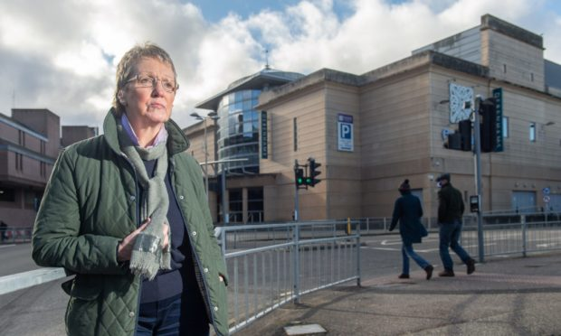 Councillor Janet  outside the Eastgate Shopping Centre.