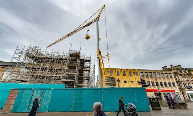 A large crane has arrived at the Poundland building in Elgin.