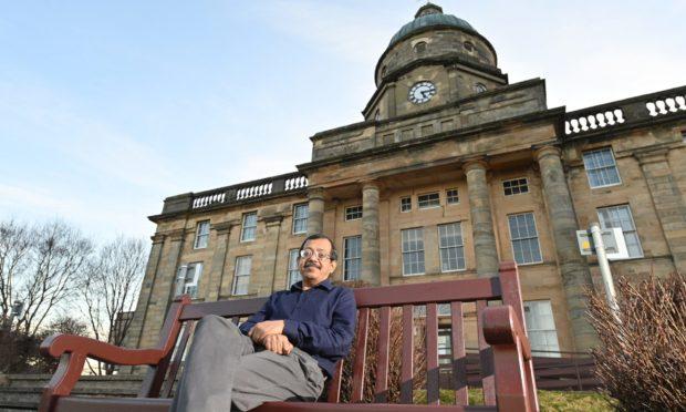 Dr Sandip Halder outside Dr Gray's Hospital in Elgin.