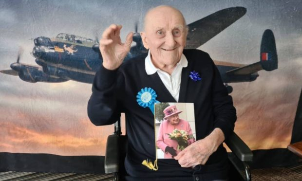 James Crook was given help by Sight Scotland Veterans to read his 100th birthday card from the Queen.