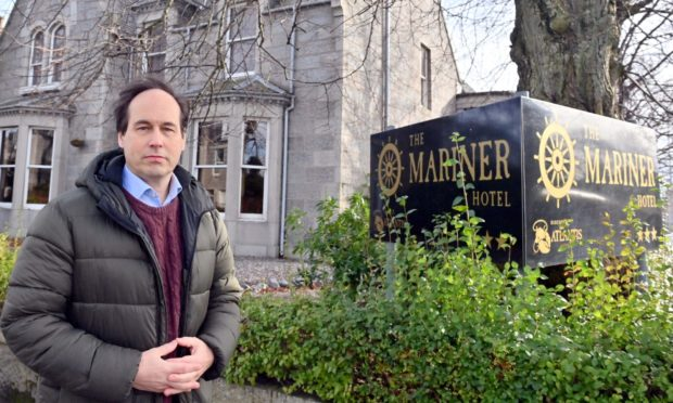 Councillor Martin Greig at the former Mariner Hotel, Great Western Road, Aberdeen.