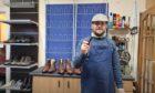 Elgin Shoe Repair's owner Kenny Morran dressed up as Peaky Blinder.