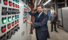 Councillor John Wheeler switches on the new district heating power supply at Tillydrone Energy Hub with Aberdeen Heat & Power Chairman Ramsay Milne.