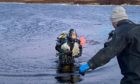 Divers working at Loch Fada in North Uist.