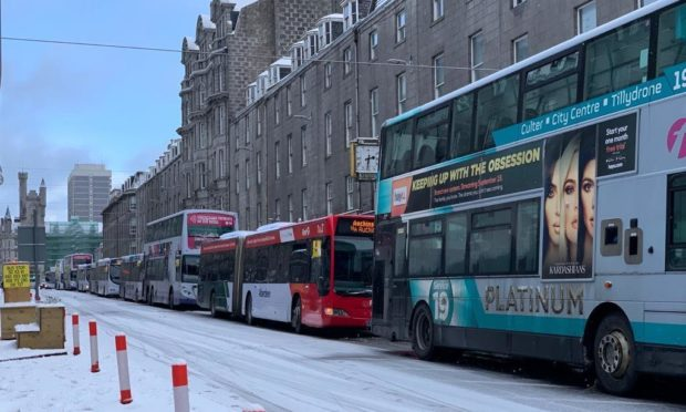 Aberdeen buses get stuck due to the snow.