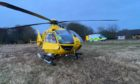Scottish Charity Air Ambulance at the scene of the accident near Longside.  Supplied by SCAA