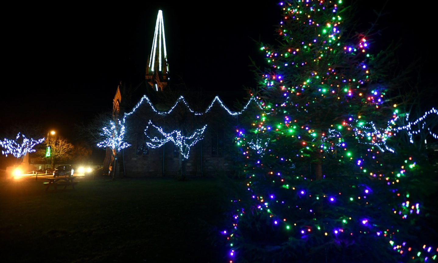 Christmas lights adorned trees and buildings throughout Ballater in December.