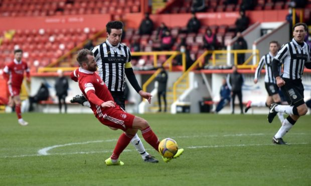 Aberdeen's Niall McGinn and St Mirren's Joe Shaughnessy pictured on Saturday, after McGinn slipped when through on goal. Picture by Darrell Benns