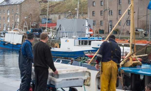 Fishermen at Burghead Harbour.