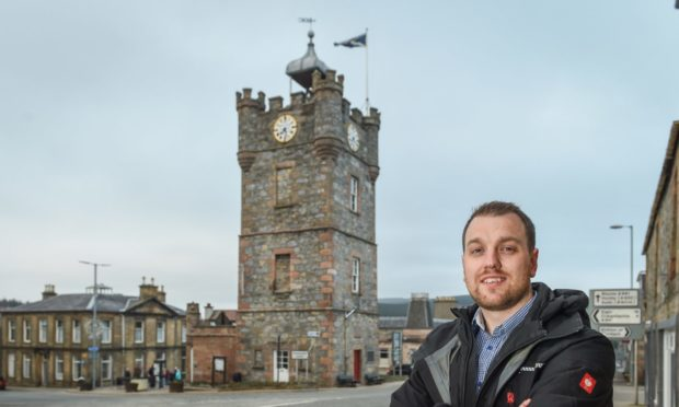 Chairman of Dufftown Community Association, Fraser McGill with the clock tower in the background.