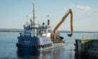 Selkie dredging at Burghead Harbour.