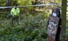 Police sealed off a section of Greenfern Woods, near Barvas Walk, following reports of a rape. Picture by Kenny Elrick