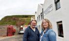 Roland and Monika Focht outside the Pennan Inn