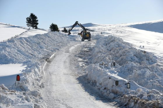 Snow clearing between Grantown and Bridge of Brown. Road currently closed