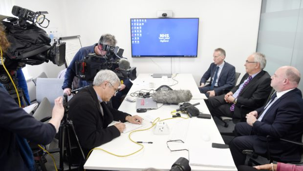 FACING THE PRESS: From left, Dr Boyd Peters, interim medical director, Professor                      Boyd Robertson, interim chairman and Iain Stewart, chief executive in 2019.
