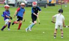 Young members of the Inverness Shinty Club play a demonstration game.