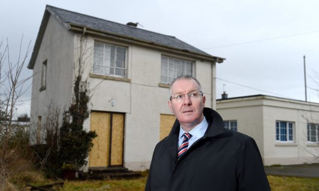 Councillor Duncan Macpherson at the empty janitor's house on Planefield Road, Inverness
