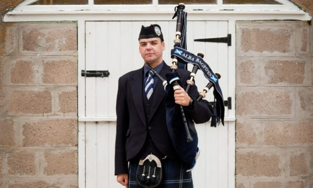 Piper and founder of Wedding Deals Scotland site, Rikki Evans, from Aberdeen.  Picture from Colin Armstrong