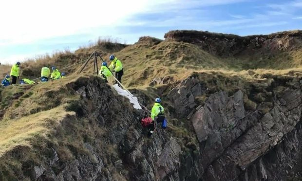 Coastguard rescue teams save the Jack Russel Mutley near the Bow Fiddle Rock, Portknockie.