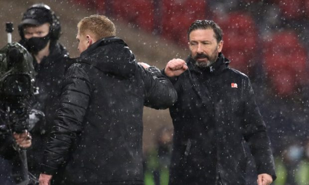 Aberdeen manager Derek McInnes (right) fist bumps Celtic manager Neil Lennon after the William Hill Scottish Cup semi final match at Hampden Park in November.