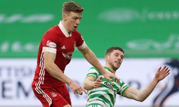 Aberdeen's Lewis Ferguson (left) and Celtic's Ryan Christie battle for the ball.