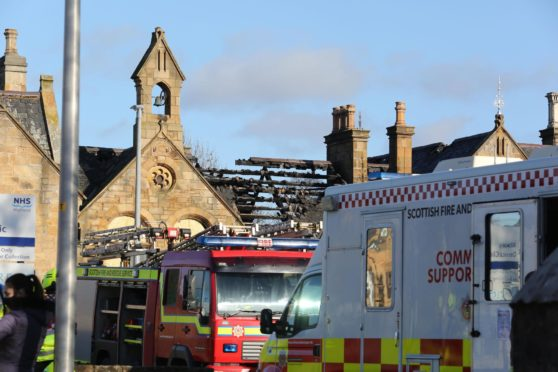 Pictures show extensive damage to the roof of the building