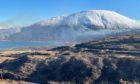 The main road through Skye has been closed as firefighters tackle a wildfire near Luib