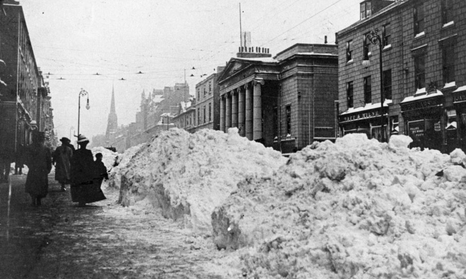 The aftermath of the great December storm of 1908 with six-foot walls of snow on Union Street.
