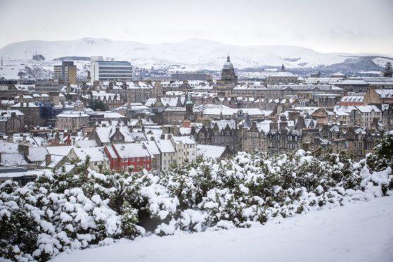 Snow covers the city of Edinburgh. Jane Barlow/PA Wire