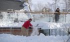 A man clearing snow in Braemar on February 11.