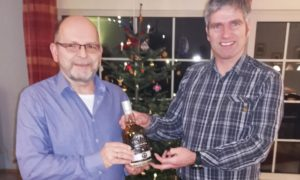 Michael Martin and Markus Knigge, two of the shareholders who sold the rare bottle