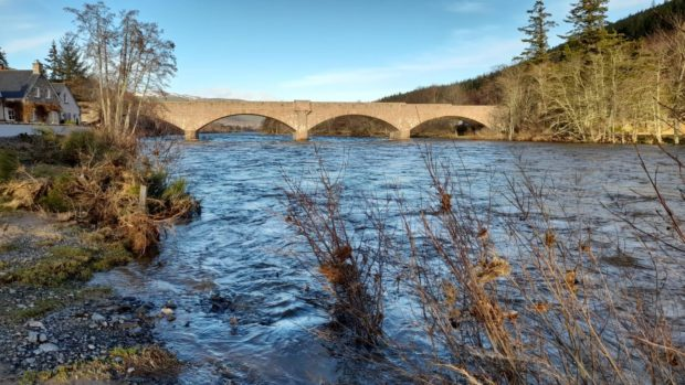 The River Dee in Ballater after a period of heavy rain and snowfall  Picture shows; The River Dee in Ballater after a weekend of heavy rain and snowfall .