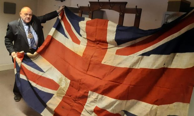 Lord Provost Barney Crockett with a Union Flag returned to Aberdeen by the mayor of Boulogne-sur-mer in 1934.