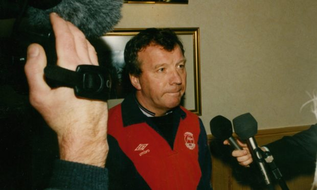 Former Dons boss Alex Smith faces the media following his sacking in 1992.