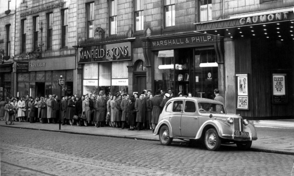 A long queue outside the The Gaumont Cinema in Union Street, Aberdeen, in 1957.