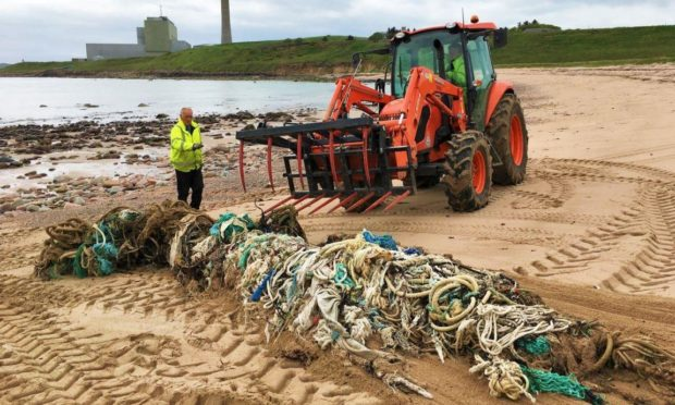 Aberdeenshire Council workers removing a one-tonne ghost net at Sandford Bay in 2019.