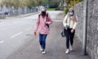 Students take a walk on Don Road, Aberdeen.