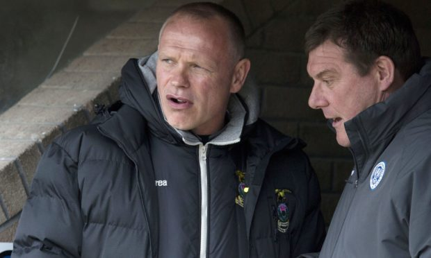 John Hughes (left) and Tommy Wright speaking before a match between Caley Thistle and St Johnstone in 2015.