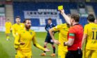 Referee John Beaton books Martin Boyle during Ross County's defeat to Hibs