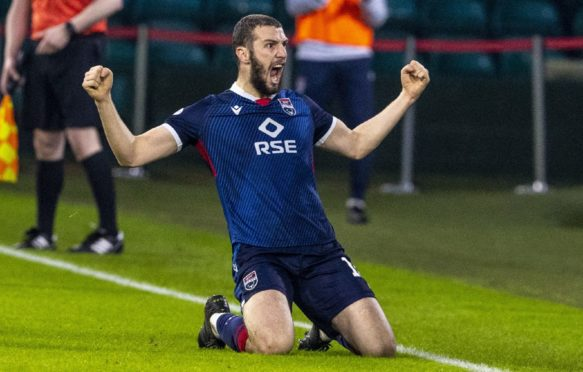 Ross County's Alex Iacovitti celebrates after making it 2-0 against Celtic in the Betfred Cup.