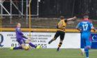 Caley Thistle goalkeeper Mark Ridgers thwarts Alloa's Alan Trouten.