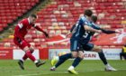 Florian Kamberi fires in a shot for Aberdeen.