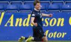 Ross County's Leo Hjelde celebrates his goal against Kilmarnock.