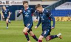 Ross County forward Billy McKay celebrates making it 3-1 with Blair Spittal.