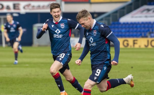 Ross County forward Billy McKay celebrates making it 3-1 against Kilmarnock with Blair Spittal.